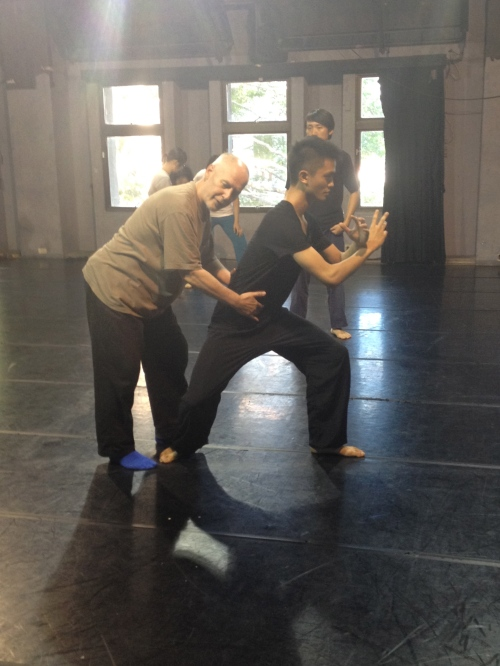 Phillip Zarrilli correcting the lion pose from Kalaripayyattu