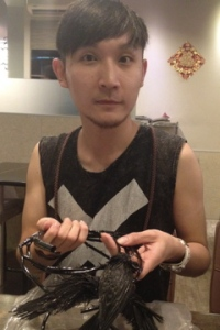 Costume designer Ys Lee with his replica of 'A Necklace of Thorns'
